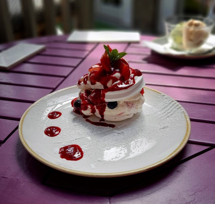 Plate with meringue and red berries