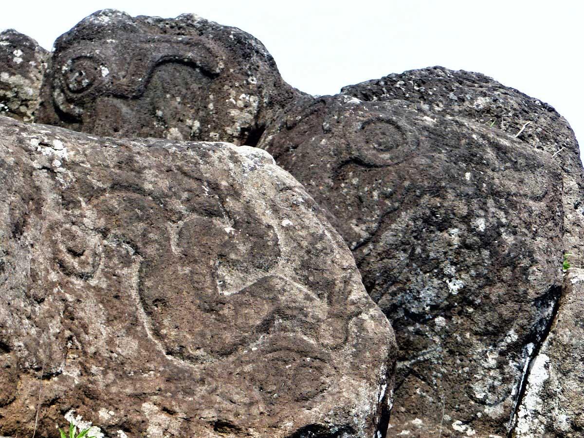 Petroglyphs on grey rocks