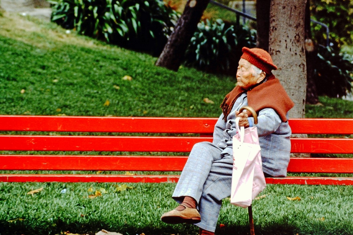 Old lady on a red bench