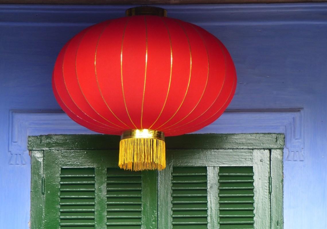 Red lantern, blue wall, green shutters