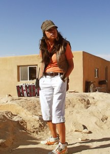 Lady in white trousers and cap