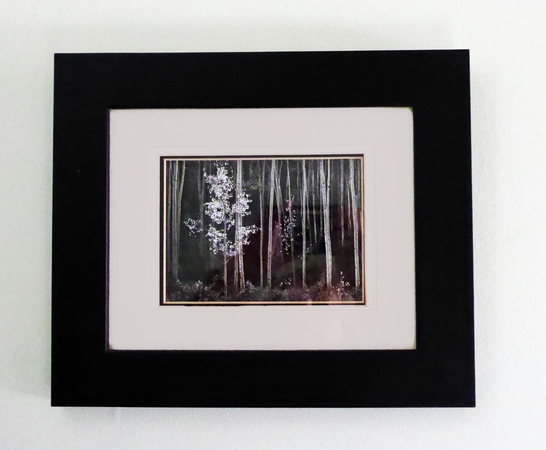 Framed black and white photo of trees
