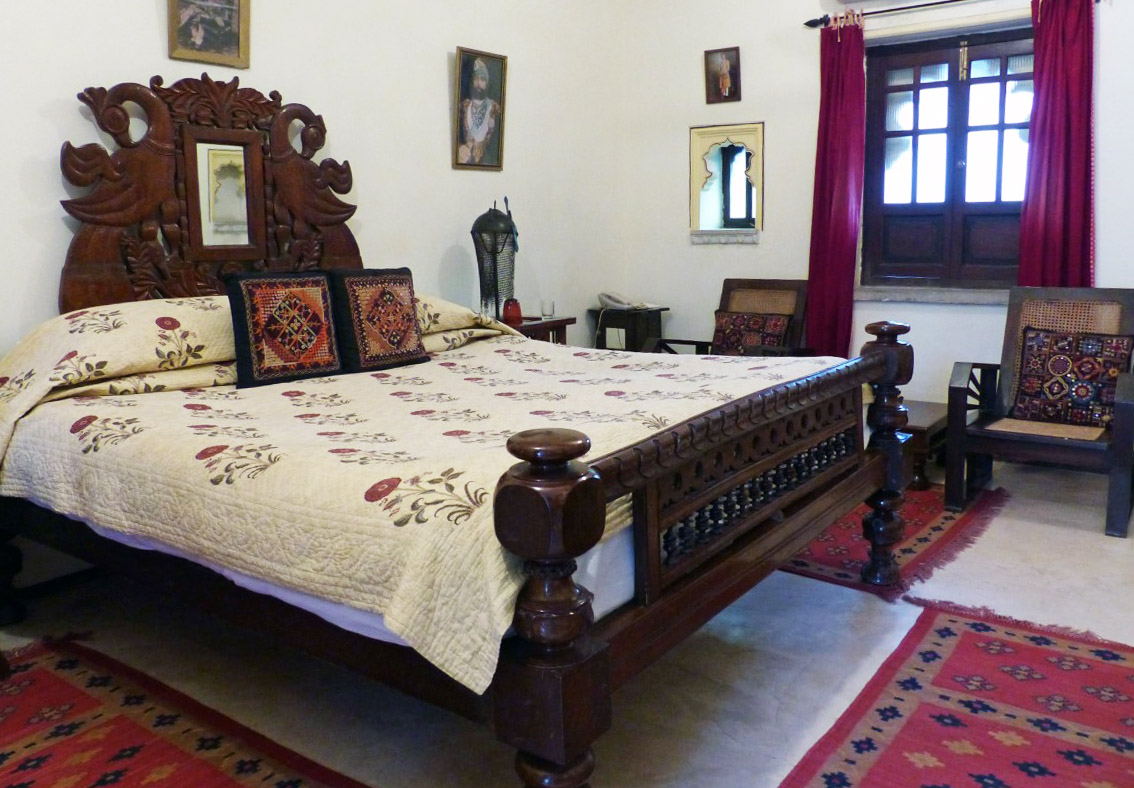 Bedroom furnished traditionally in dark wood