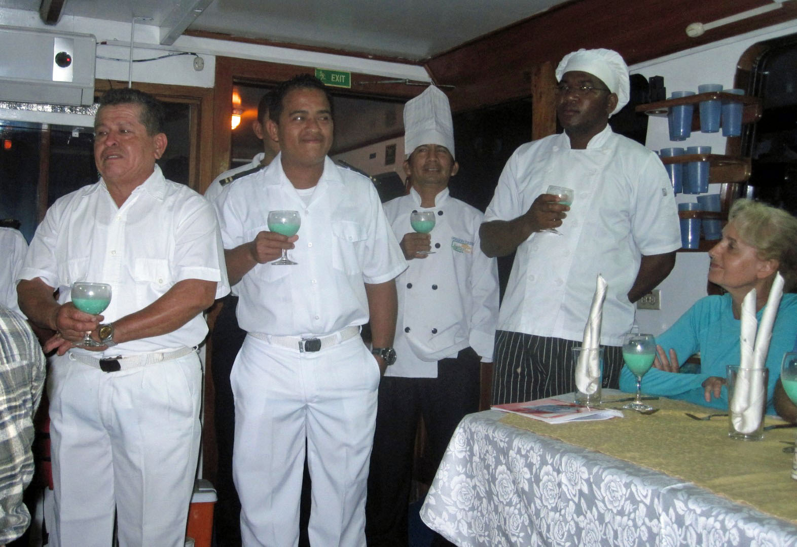 Men in white uniforms with drinks