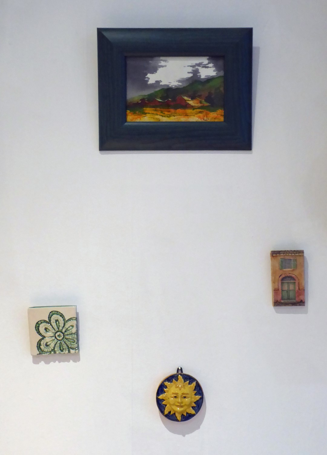 Picture and small tiles on a wall