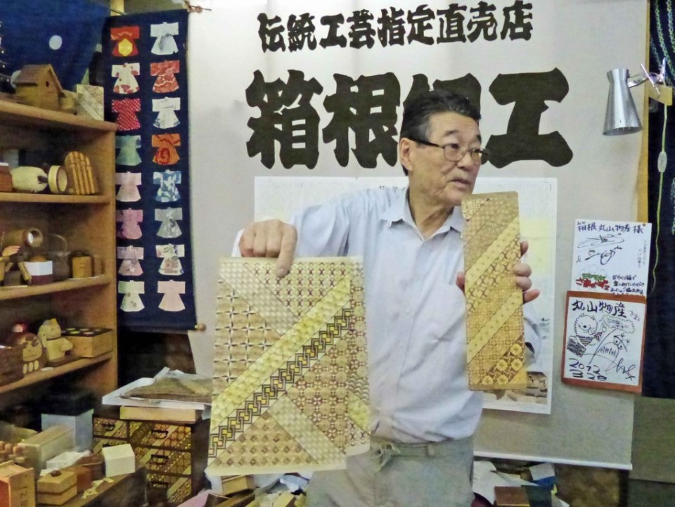 Man with intricate wood pieces