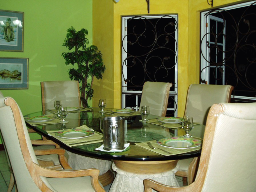 Dinner table in room with yellow walls