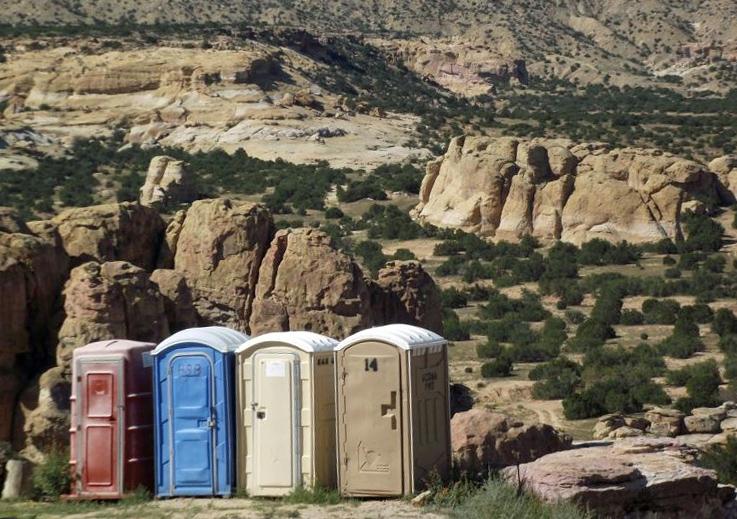 Portaloos in a desert landscape