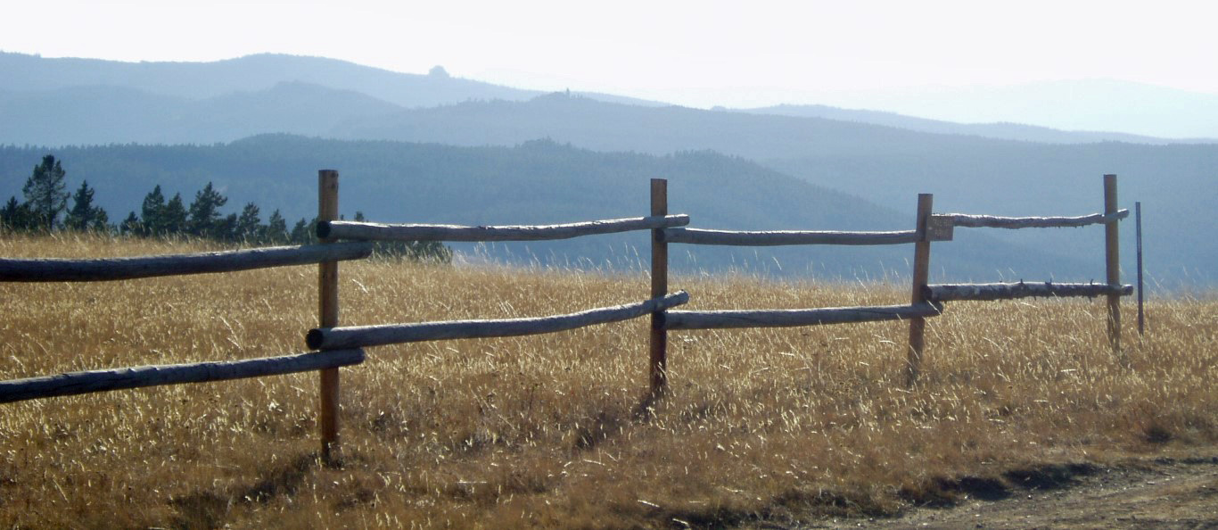 Wooden fence with hills beyond