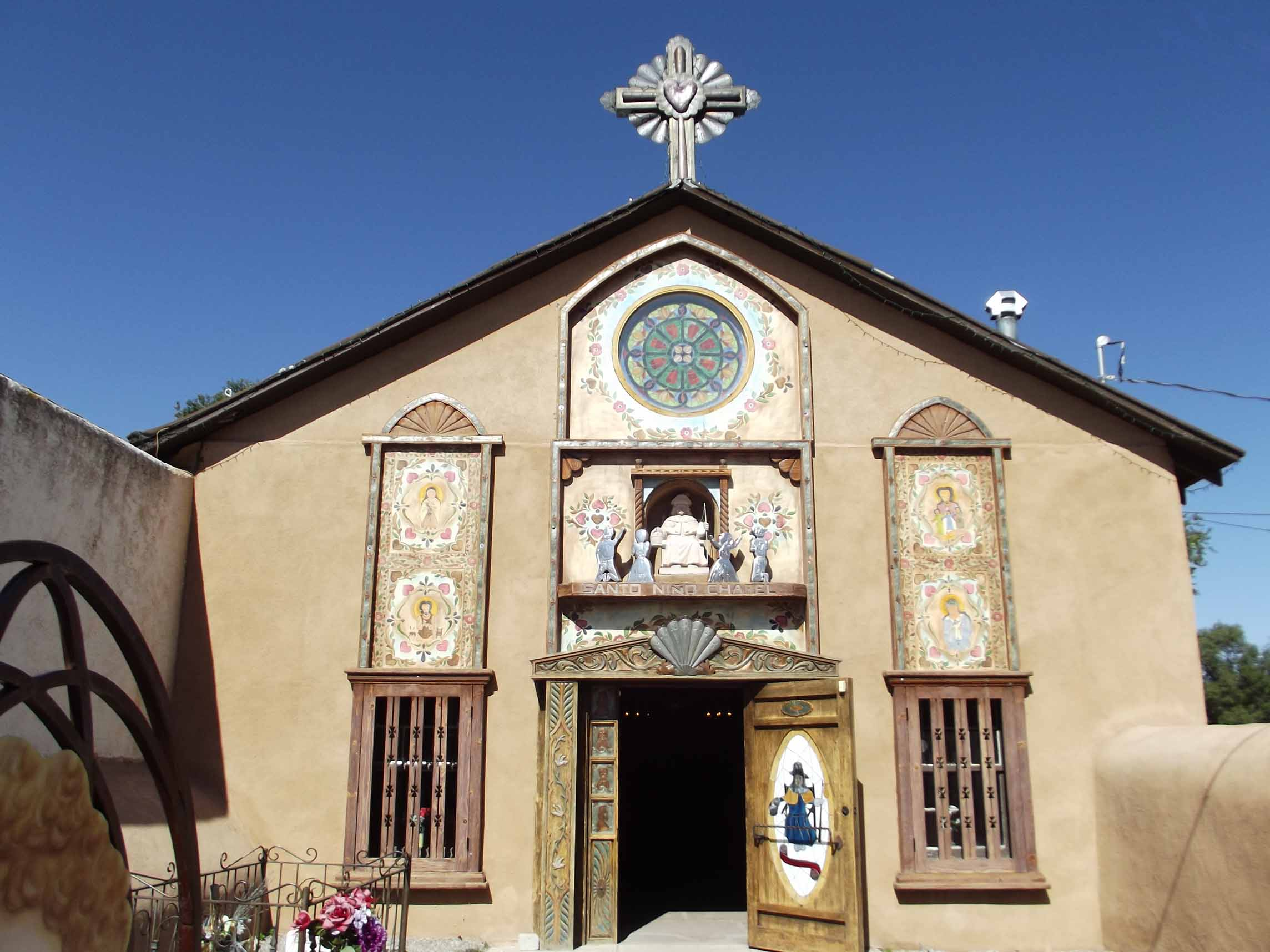 Adobe church with decorative tiles on the front