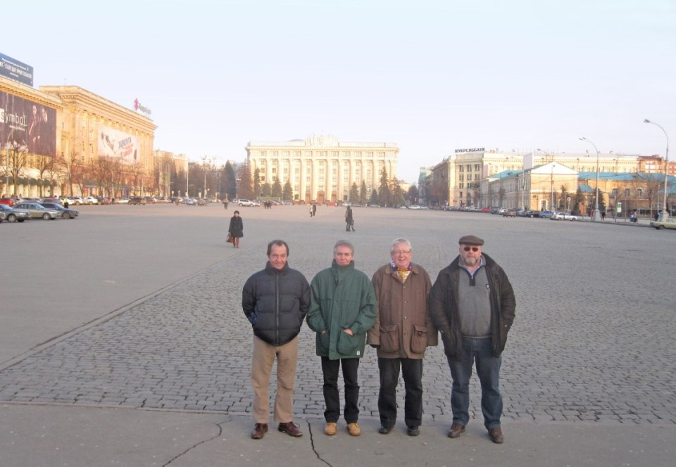 Four men in a large square