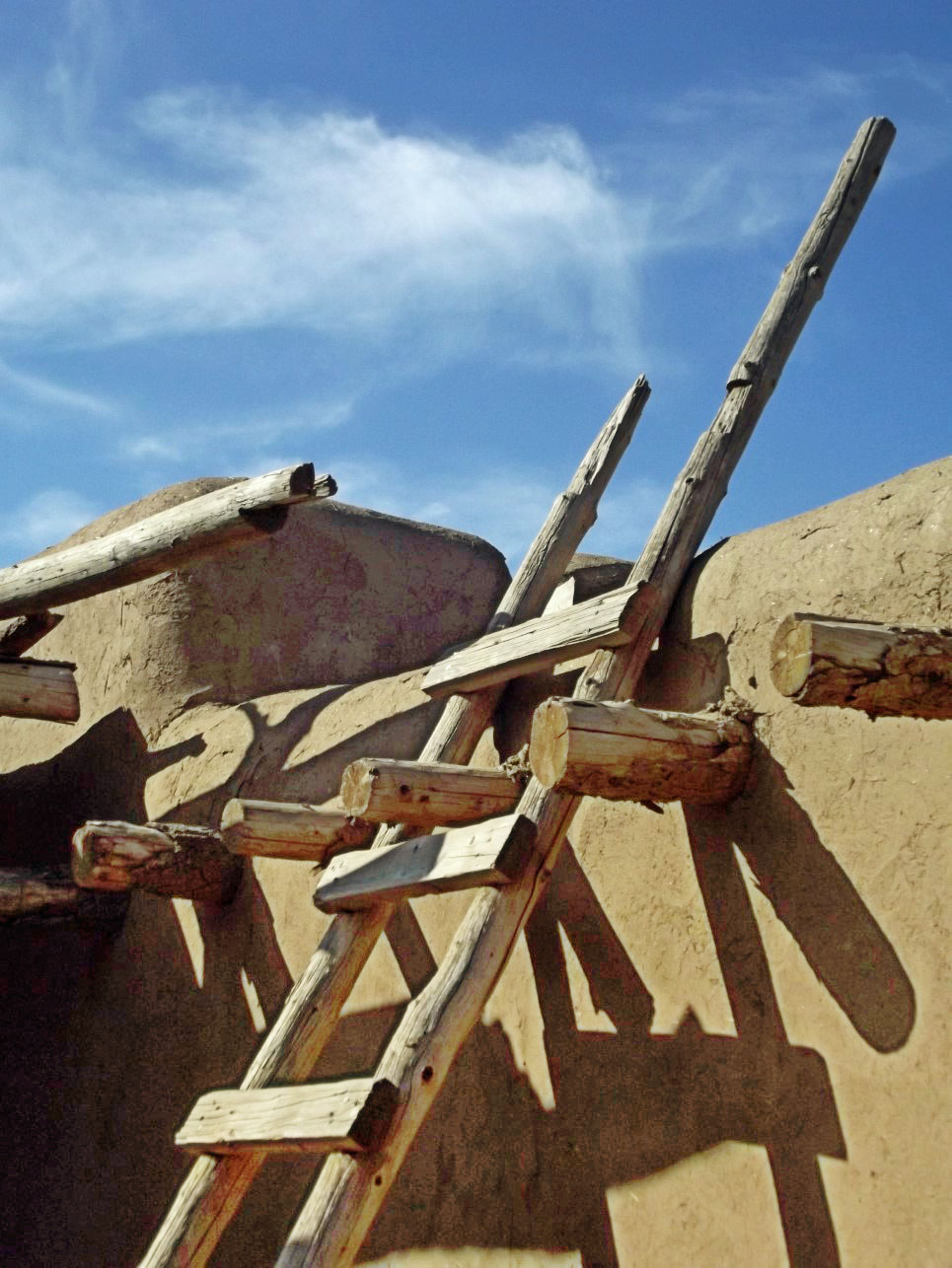 Adobe house with wooden ladder