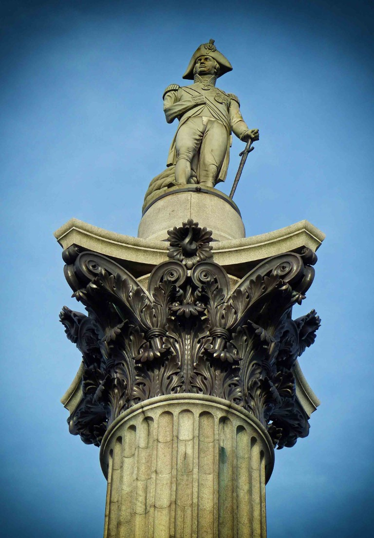 Man in naval uniform at the top of a column