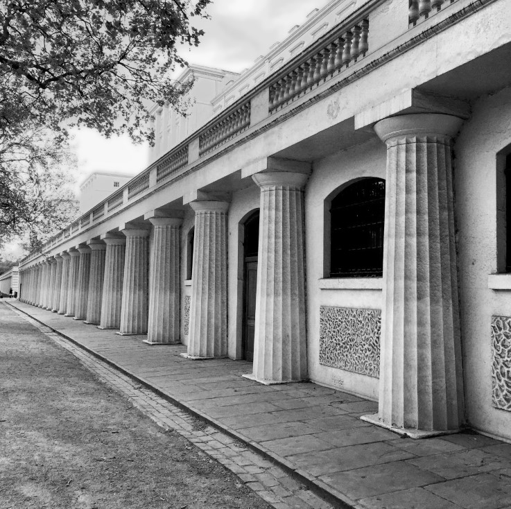 Black and white photo of a colonnaded building