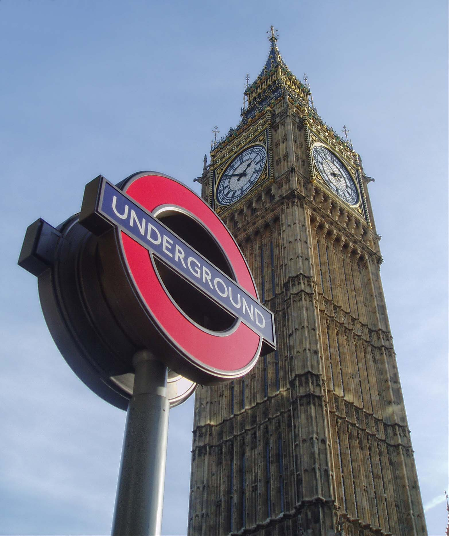 Underground sign and tall clock tower