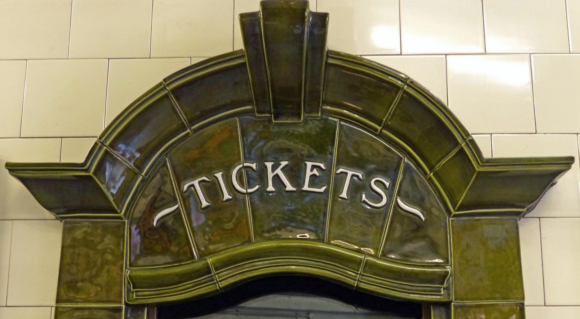 Green tiles with tickets sign