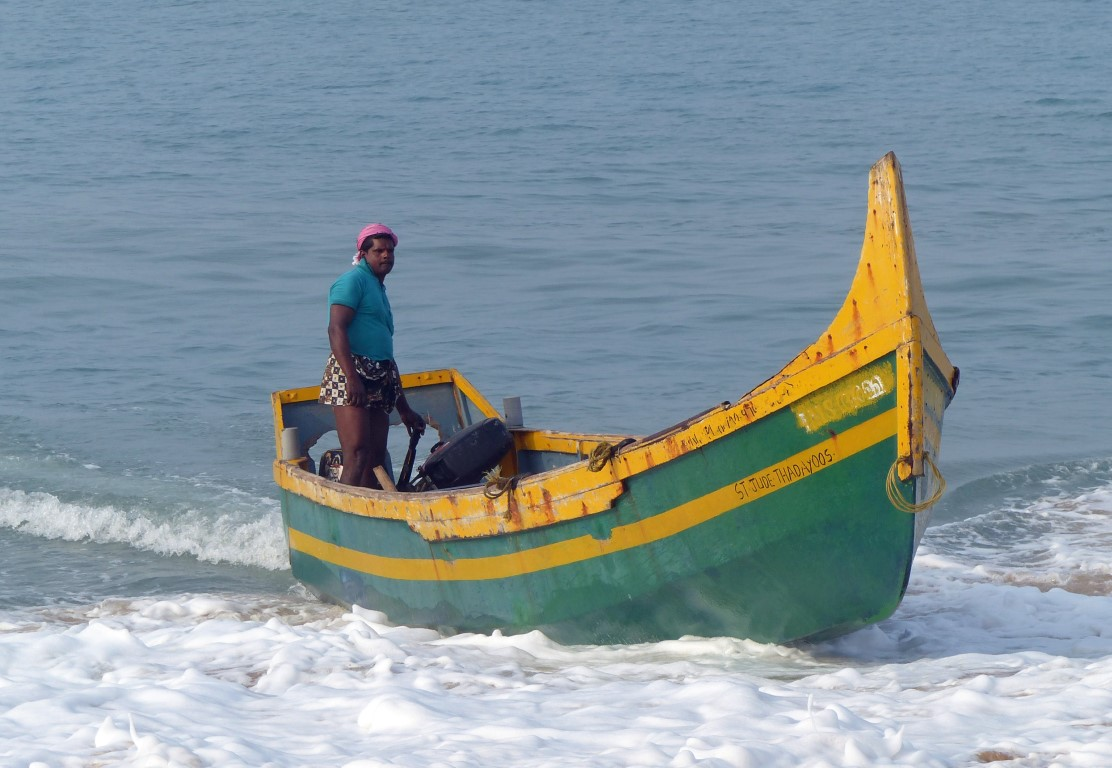 Man in a small green boat