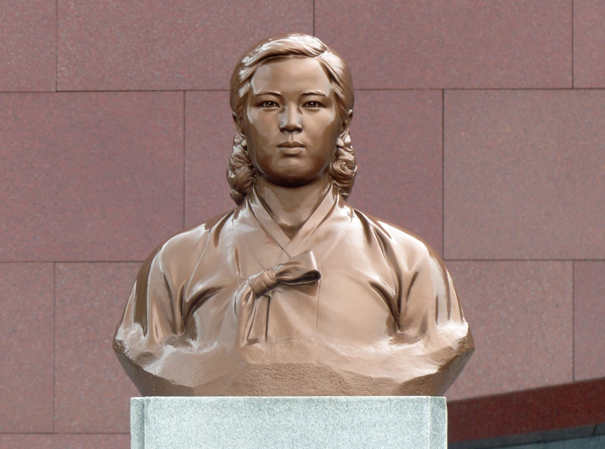 Bronze bust of young woman