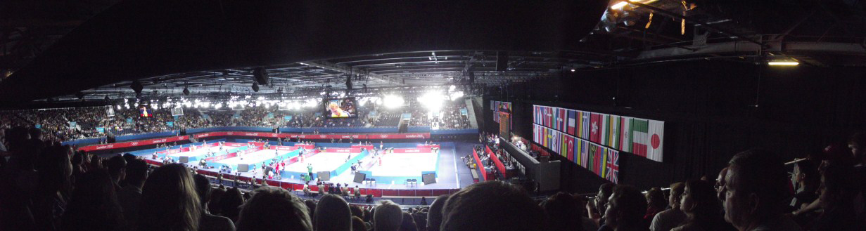 Panorama of arena with four table tennis tables