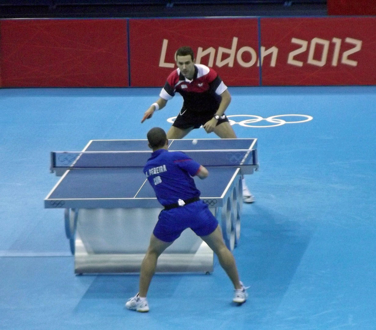 Two men playing table tennis