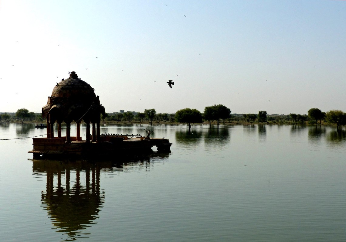 Lake with domed structure and birds