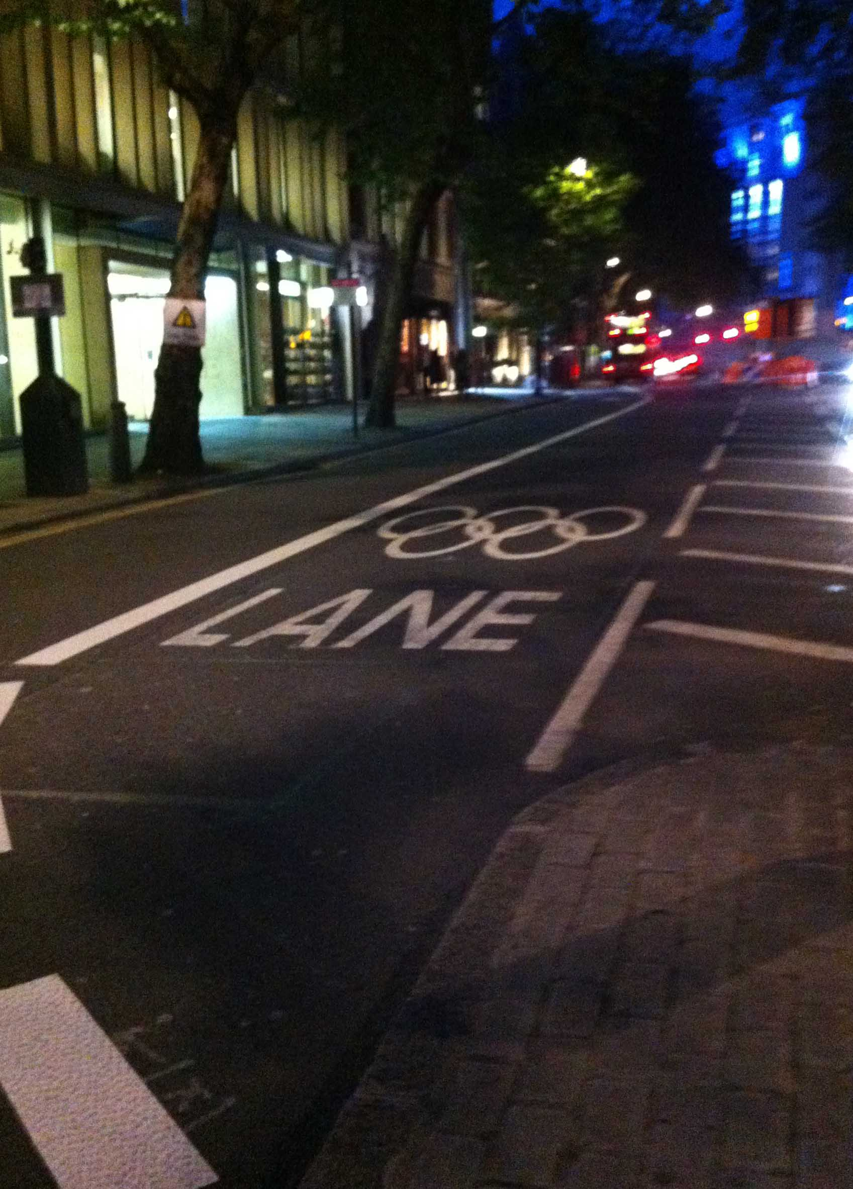 Road lane marked with Olympic rings