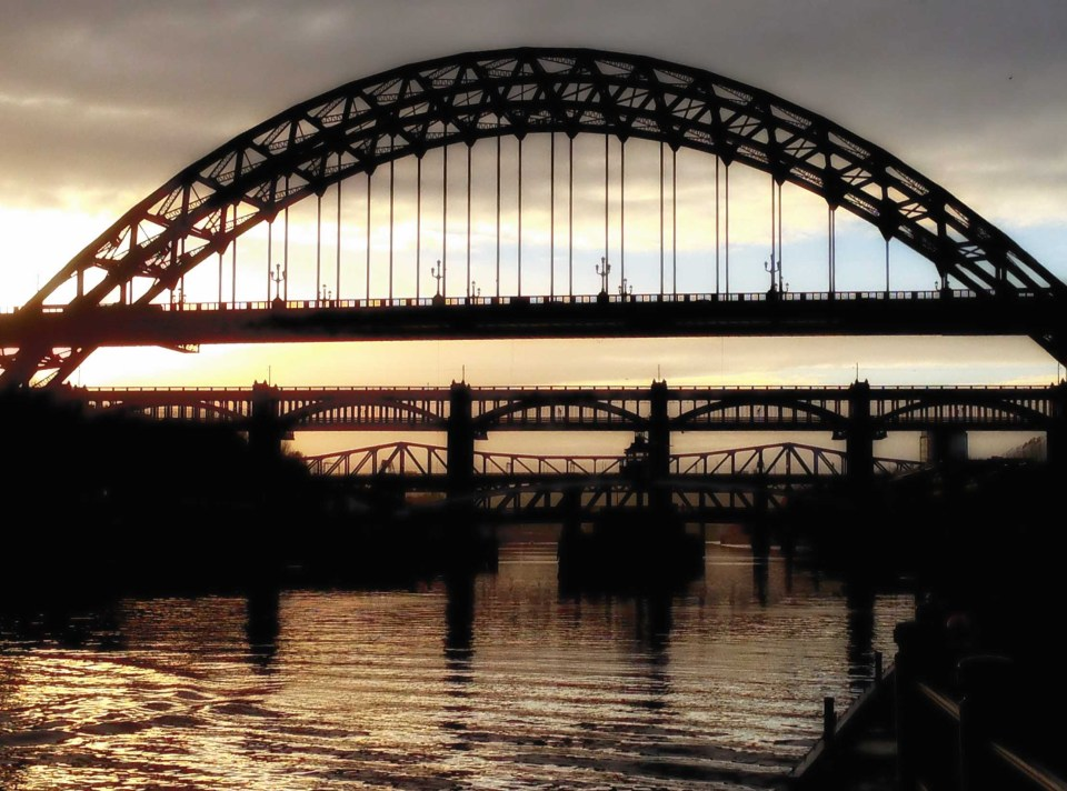 Several bridges silhouetted against the sky