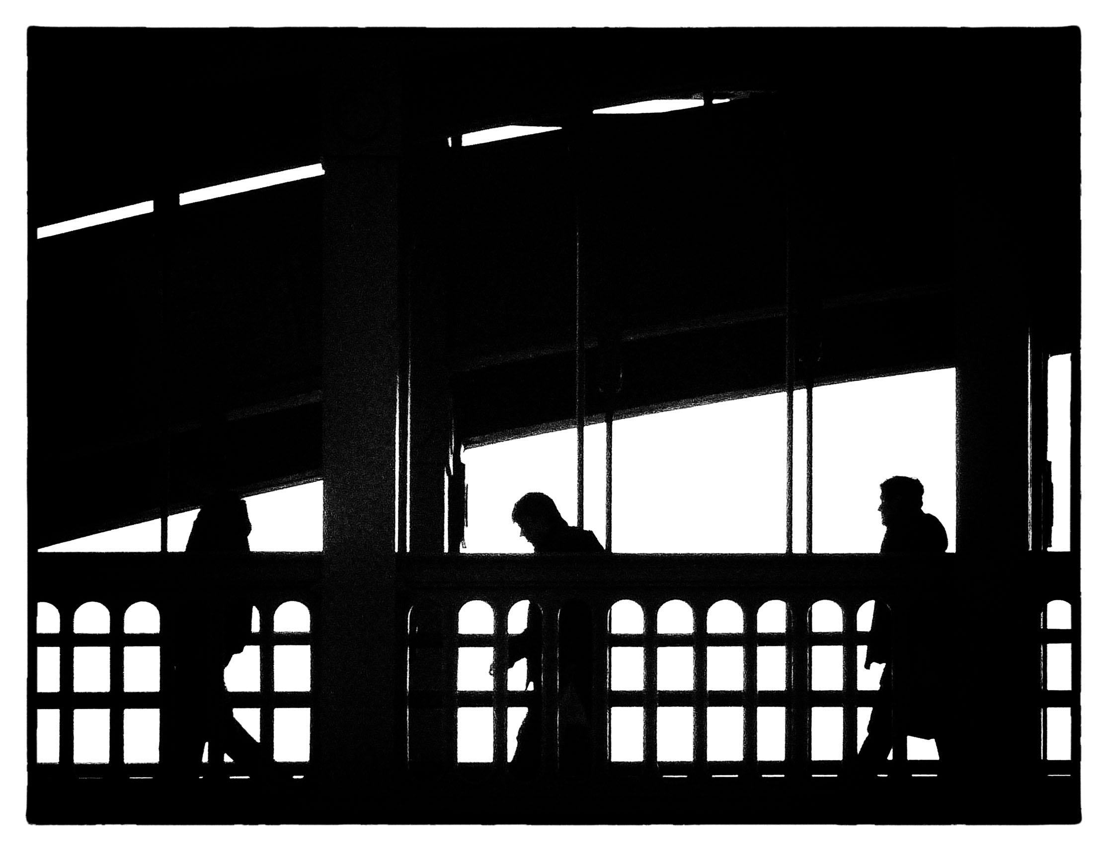 People on a bridge in silhouette