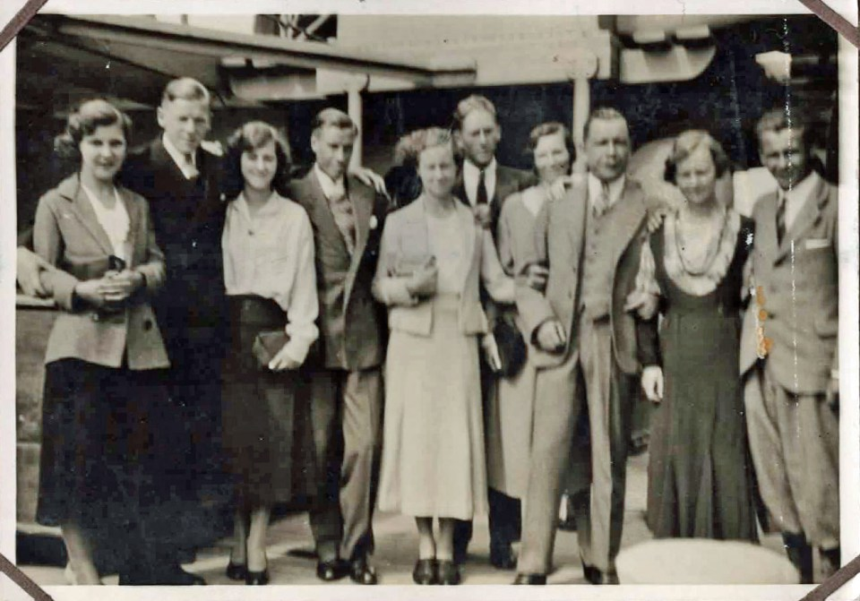 Old photo of people on a ship
