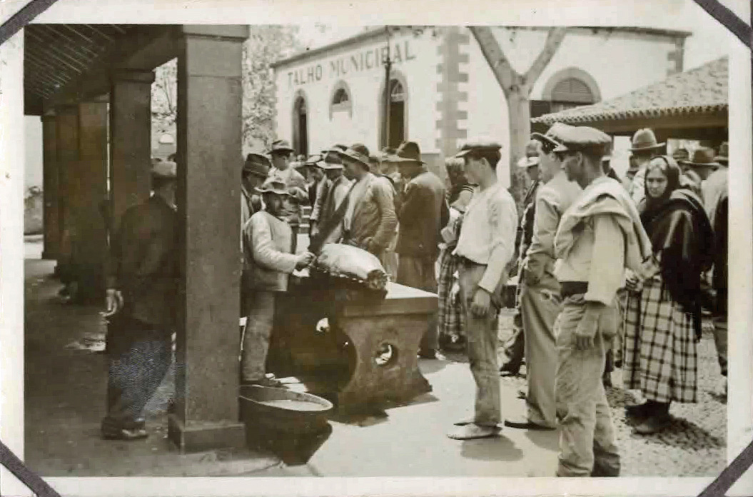Old photo of people in a market