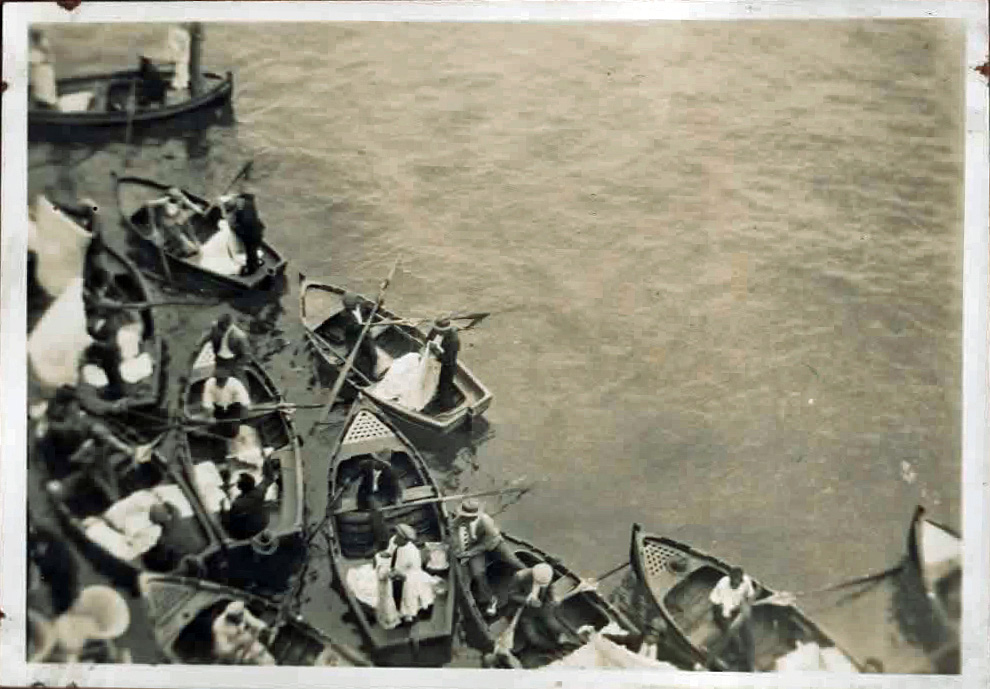 Old photo of small boats from above