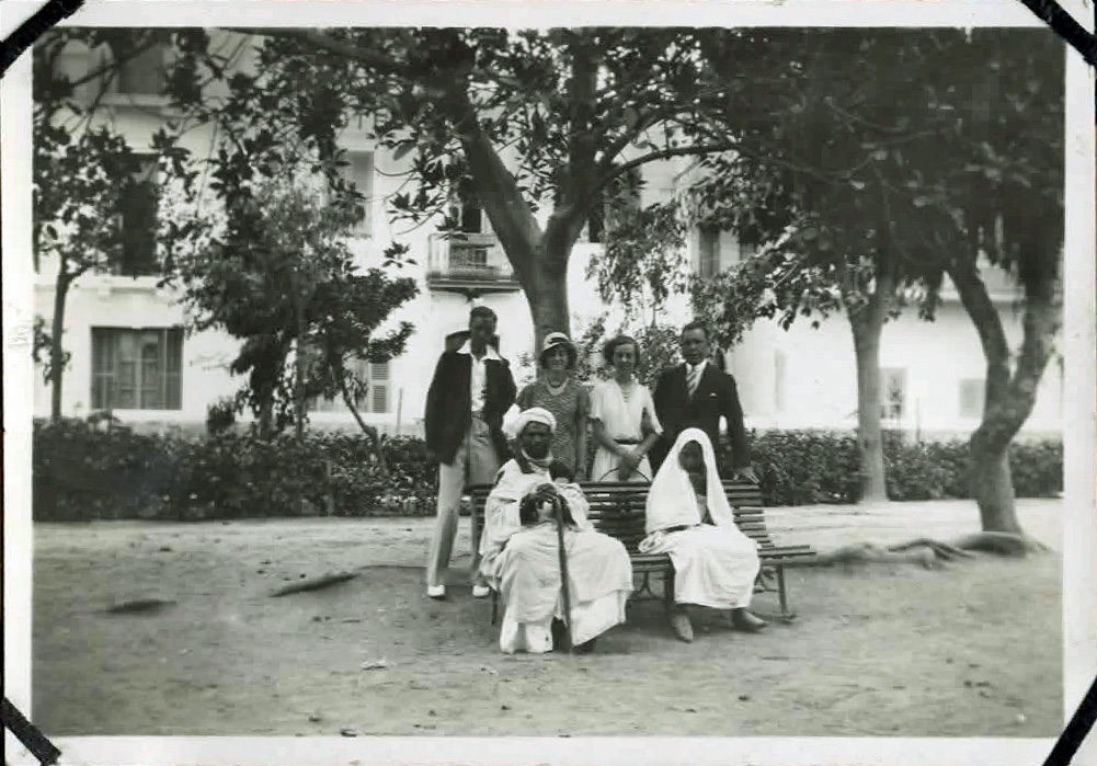 Old photo of people posing in a park