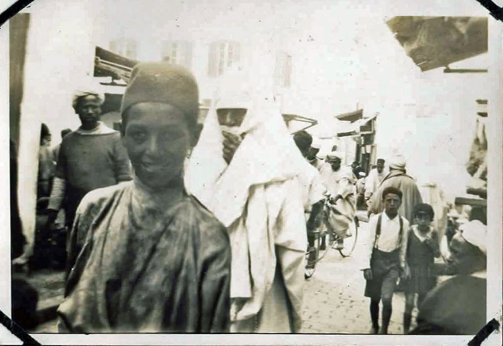 Old photo of people in a busy market