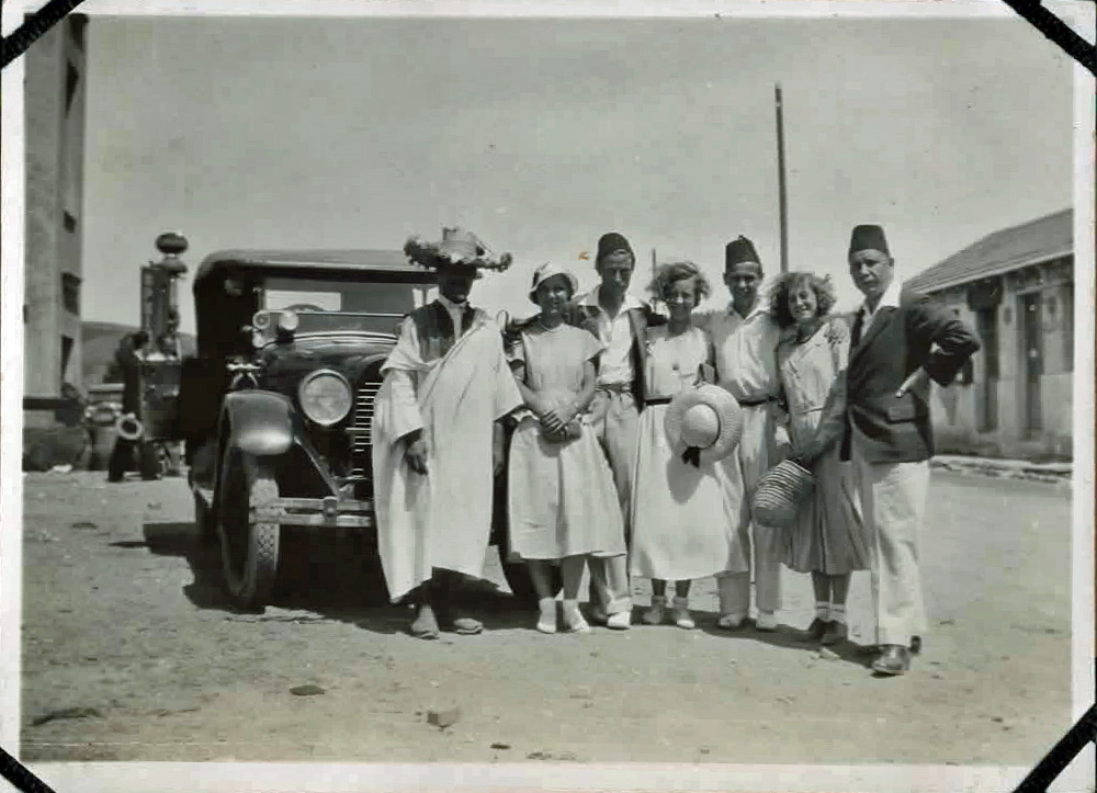 Old photo of people and a car