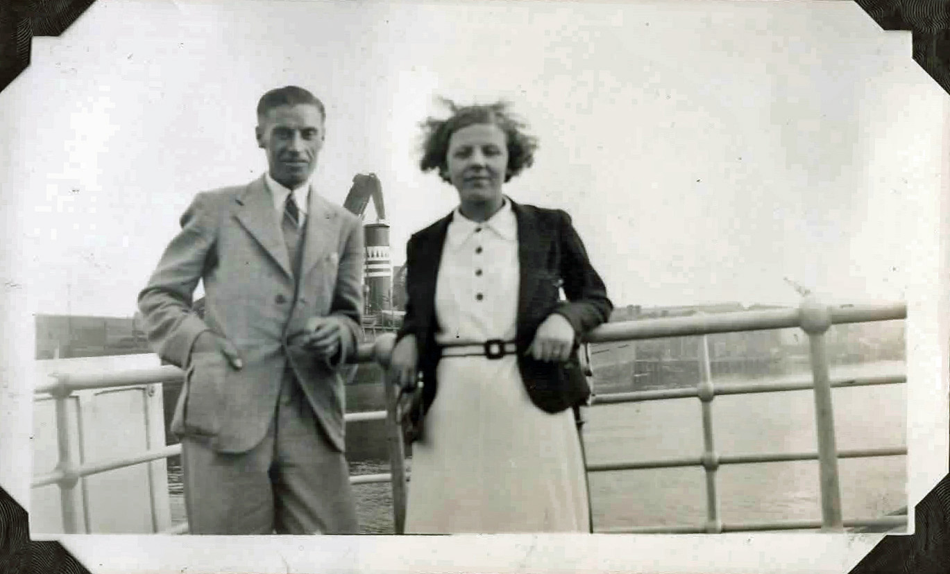 Old photo of a couple on a ship