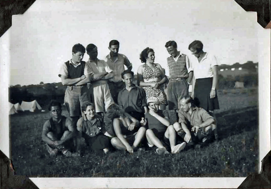 Old photo of group posing for camera