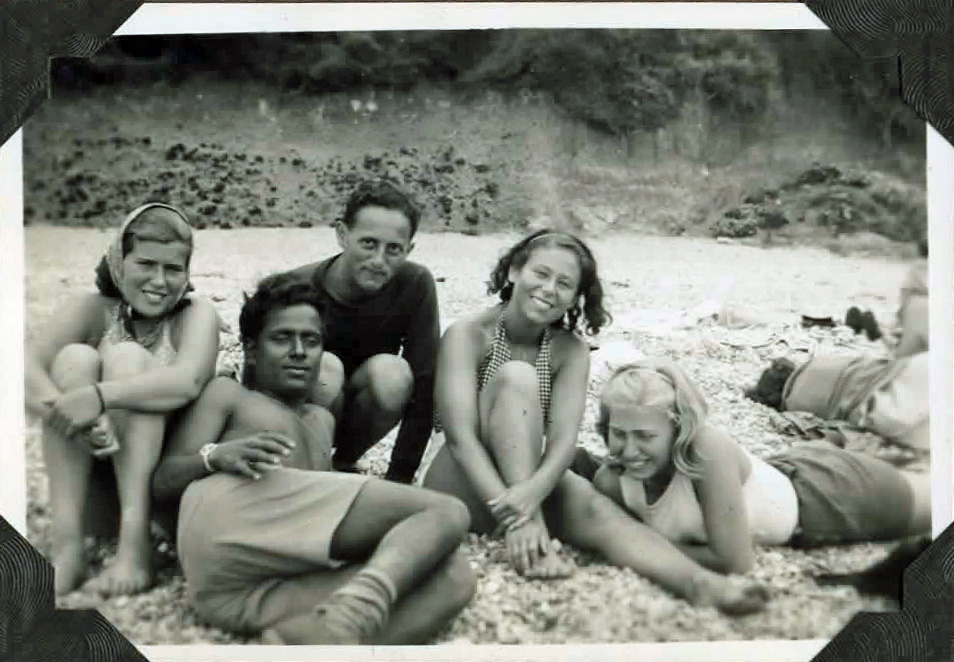 Old photo of people on a beach