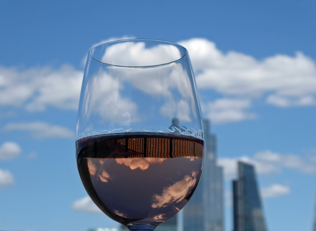 Glass of wine with skyscrapers behind