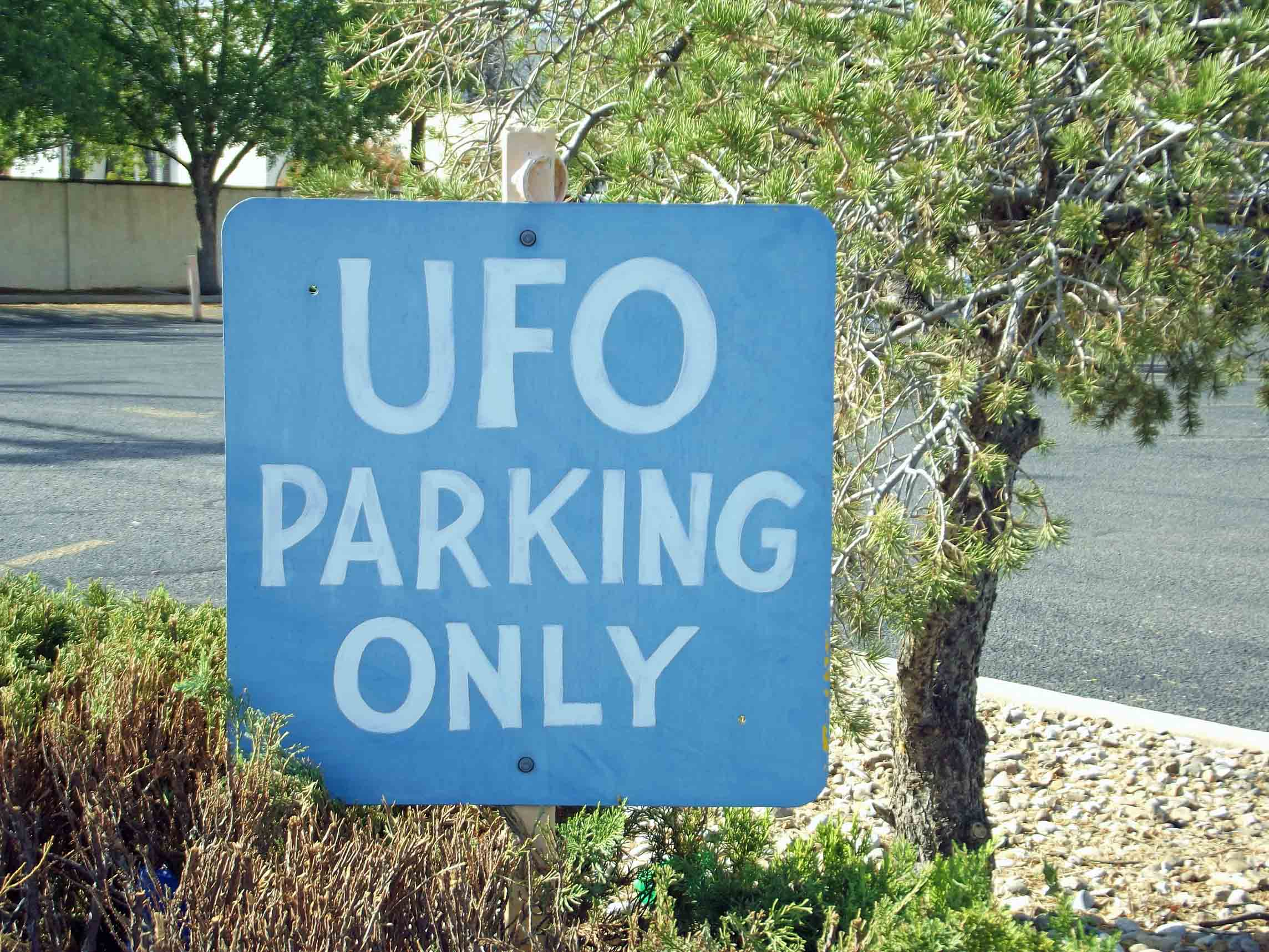 Sign saying UFO parking only