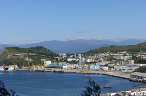 View of a town on a bay with mountains behind