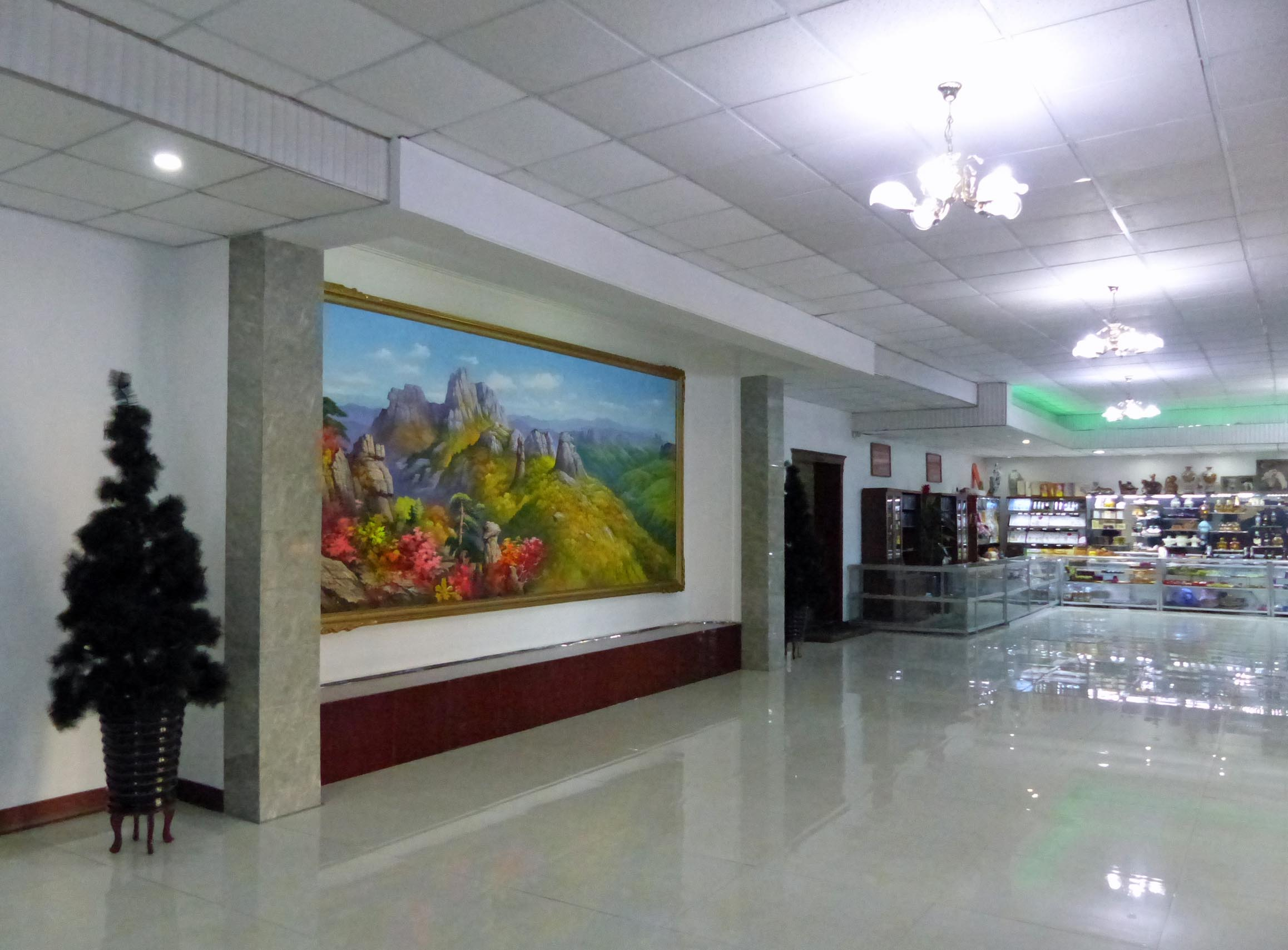 Hotel lobby with shiny floor and big landscape painting