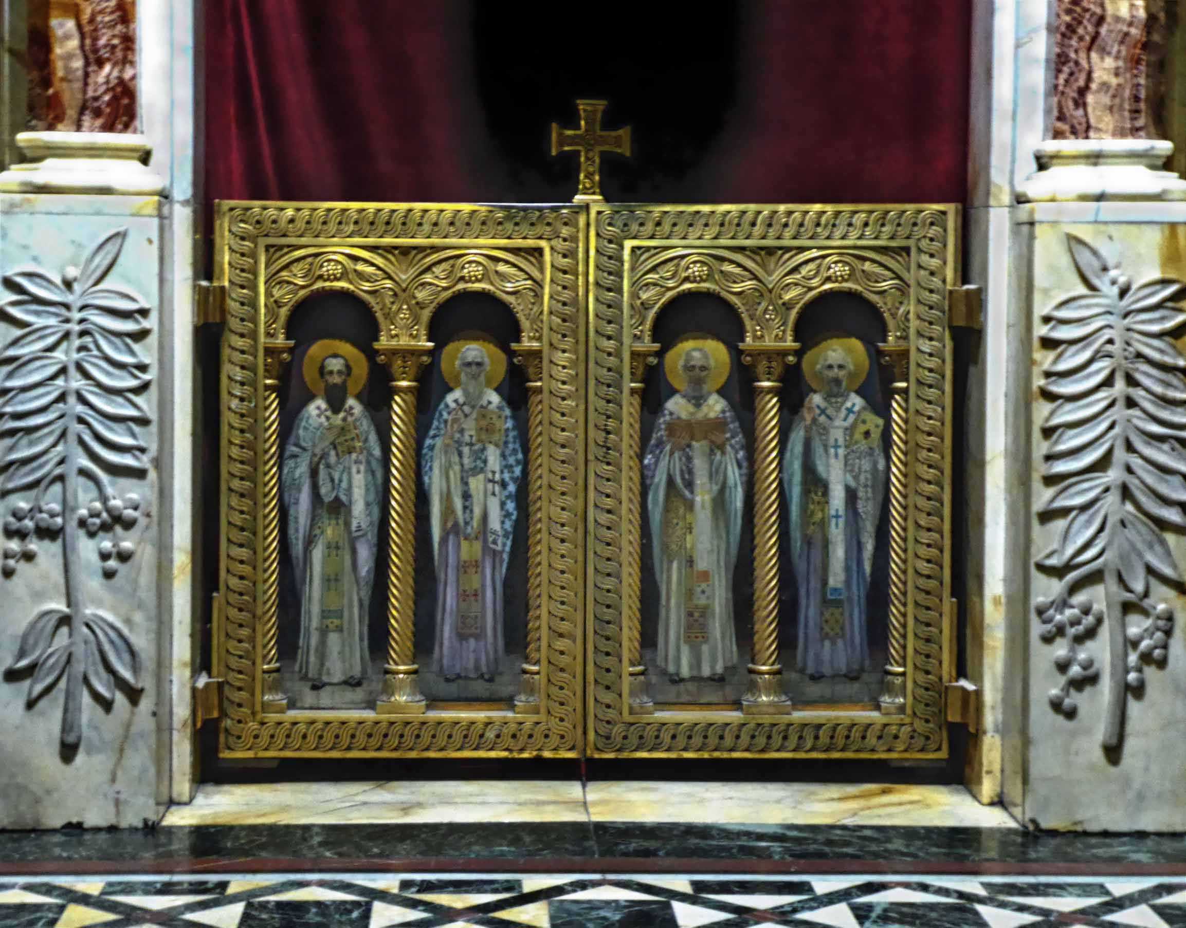 Images of four saint with ornate gold frame