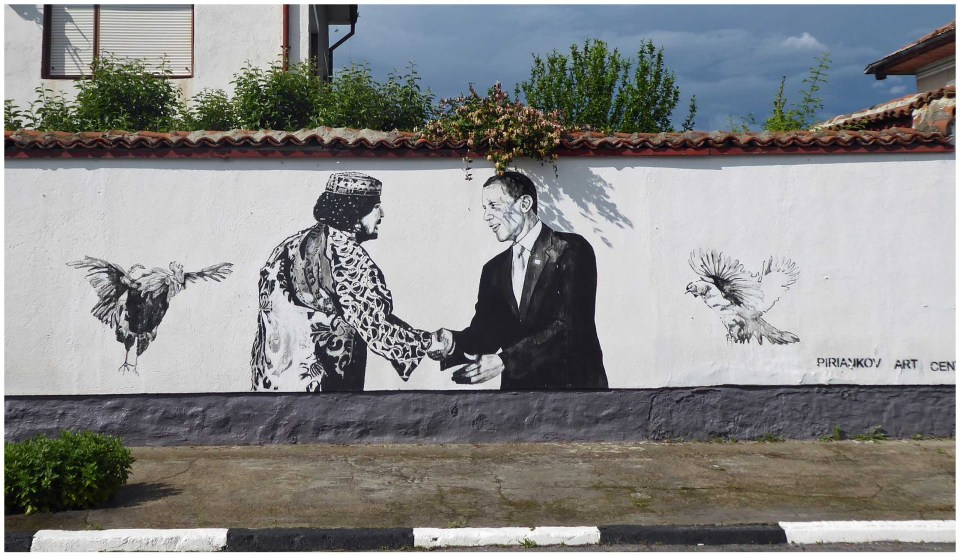 Mural of Barack Obama with a man and some chickens