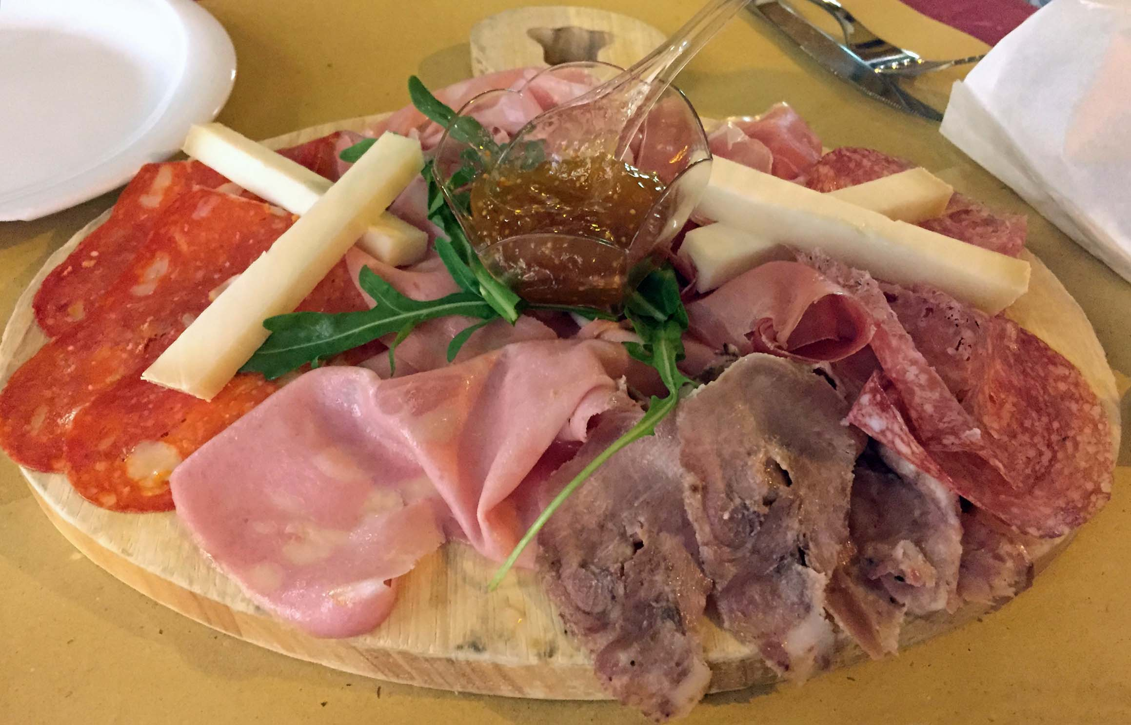 Cold meats and cheese on a board