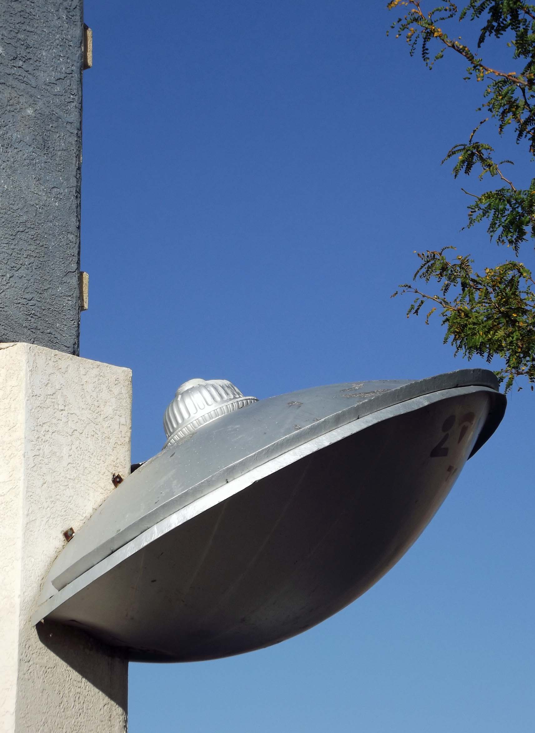 Model of flying saucer attached to a building