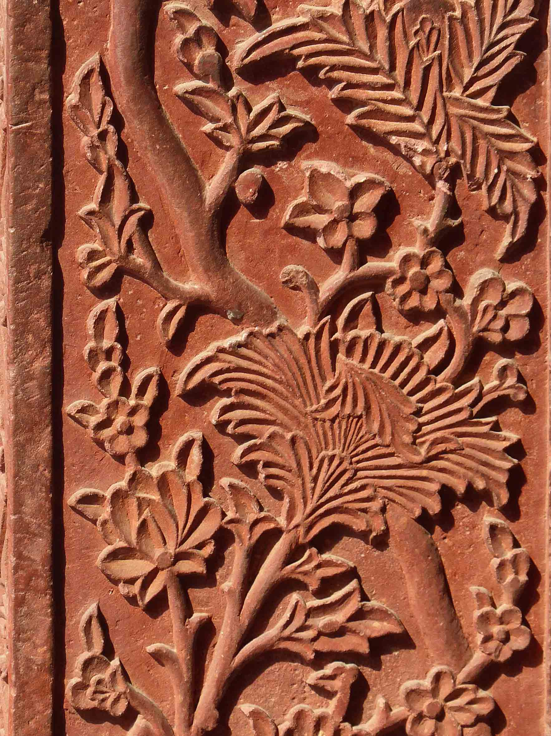 Red sandstone carving of leaves and flowers