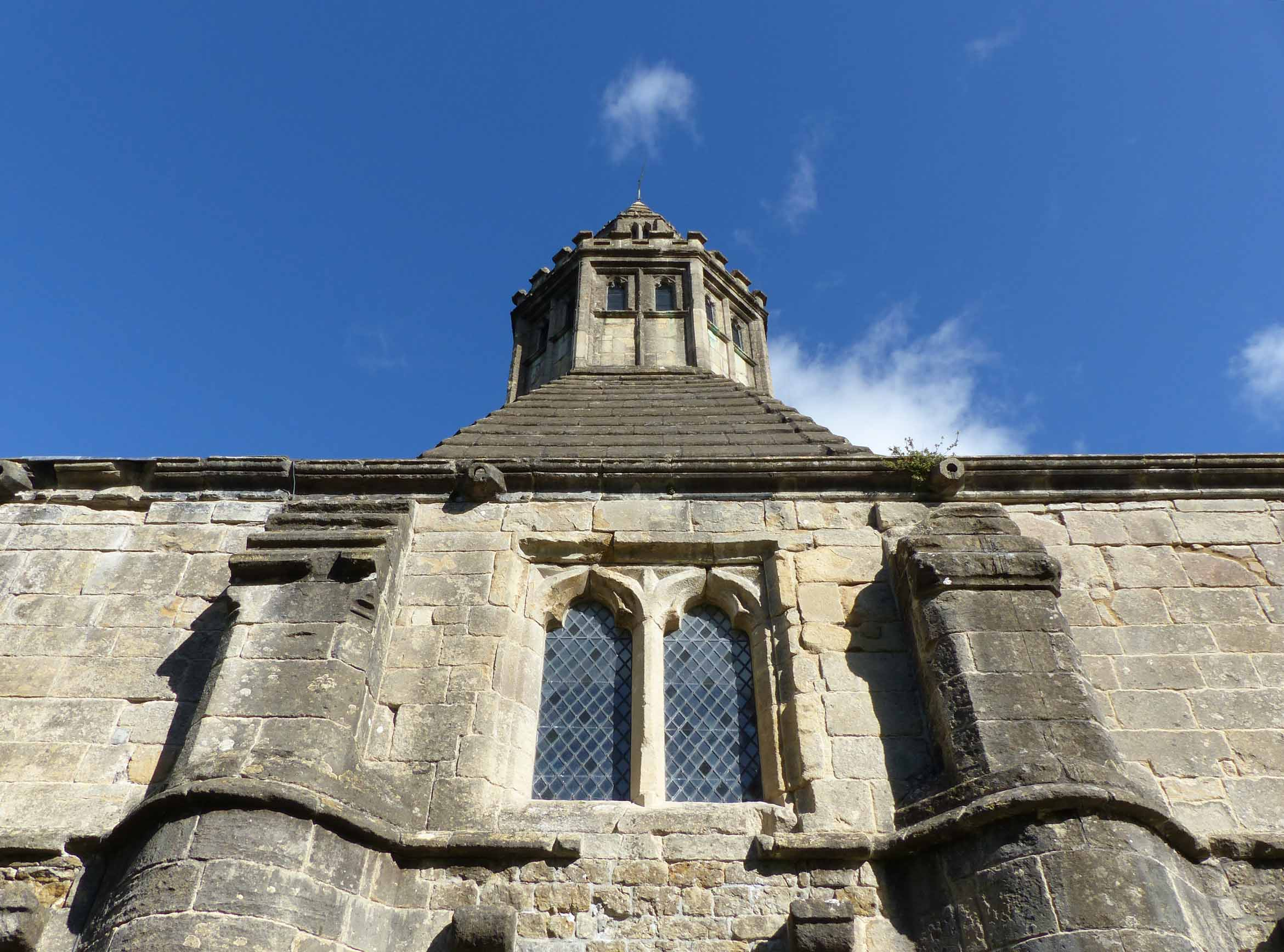 Looking up at a stone building
