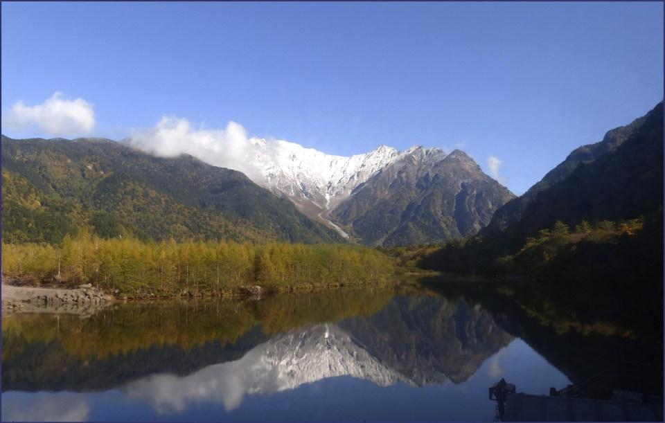Lake reflecting surrounding mountains