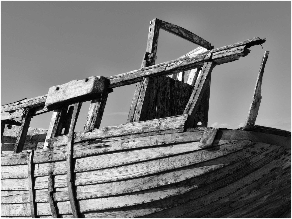 Battered timbers of an old boat, monochrome