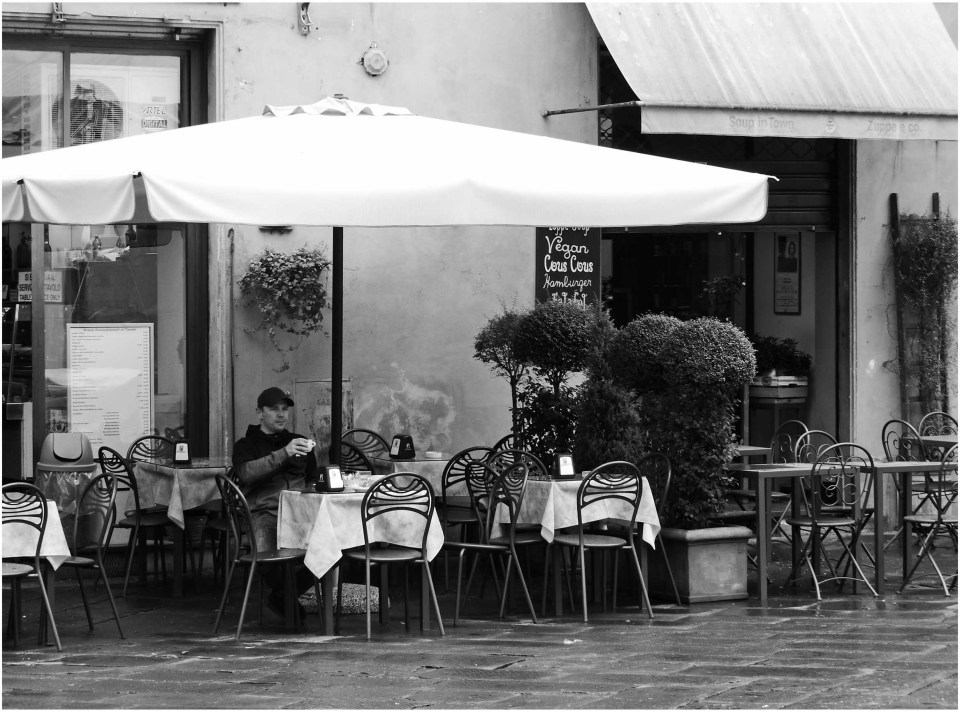 Black and white photo of outdoor cafe